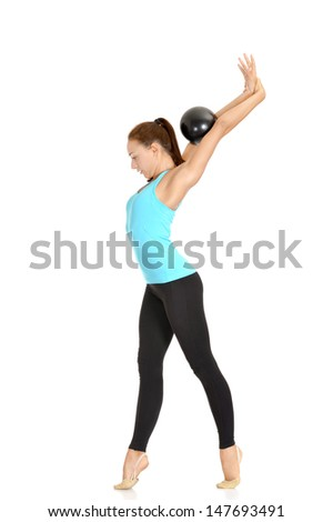 flexible girl in a blue t-shirt doing exercise on a white background