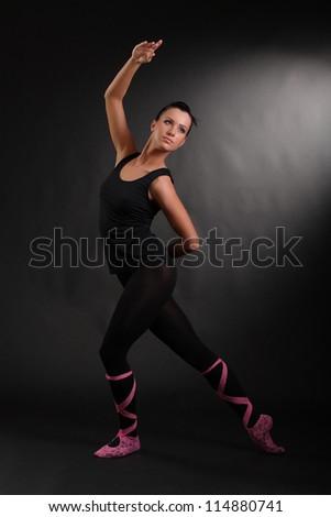 flexible girl on a black background - stock photo