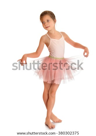 Flexible little charming ballerina in a pink dress - Isolated on white background - stock photo