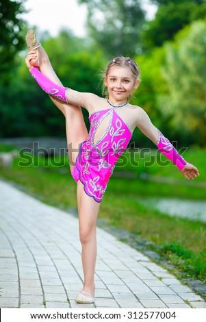 Flexible Little Girl Doing Gymnastics Vertical Stock Photo