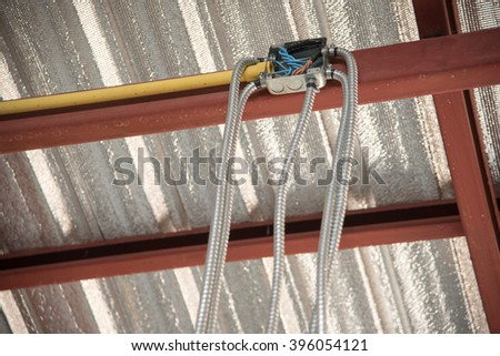 Flexible metal pipe in construction site - stock photo