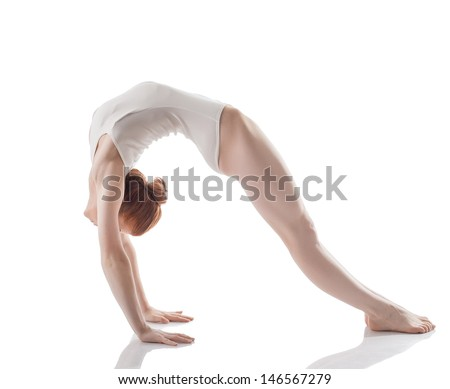 Flexible slim girl doing gymnastic bridge