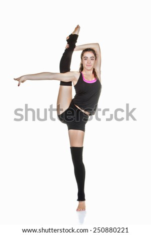 flexible teen ballet dancer stretching exercise - stock photo
