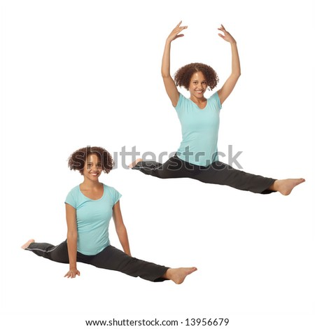 Flexible young woman doing a split with lowered and raised arms