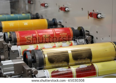 Flexo press for printing label. Flexography (also called surface printing), often abbreviated to flexo, is a method of printing most commonly used for packaging (labels, tape, bags, boxes, banners). - stock photo
