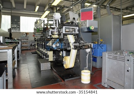 Flexo printer. Flexography, often abbreviated to flexo, is a method of printing most commonly used for packaging, labels, tape, bags, boxes, banners. - stock photo
