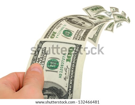Flies, flying in a pack of dollars in a hand. - stock photo