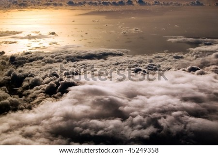 flight above the clouds, at evening - stock photo