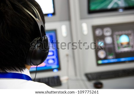 flight controller working in the flight control tower. - stock photo