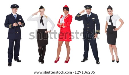 Flight crew members, pilots, stewardesses. Isolated on white - stock photo