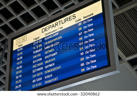 Flight departure information board at airport