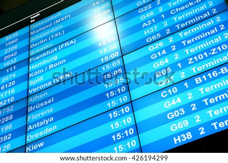Flight information board in airport - stock photo