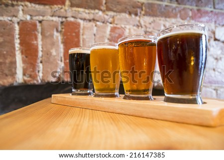 Flight of Four Beers for Tasting in a Pub - stock photo