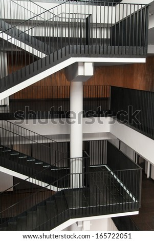 Flight of stairs with metal railing inside building