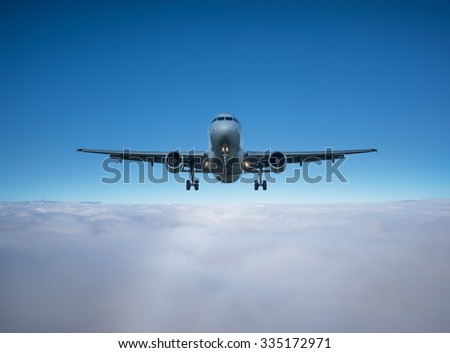 Flight of the plane above the clouds before landing. - stock photo