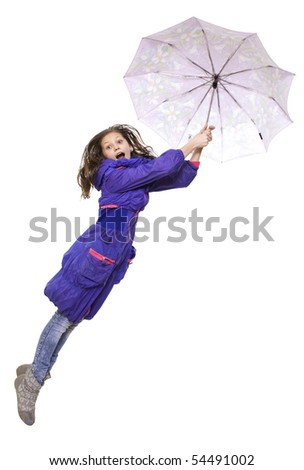 Flight of the teenager in turn blue raincoat with umbrella - stock photo