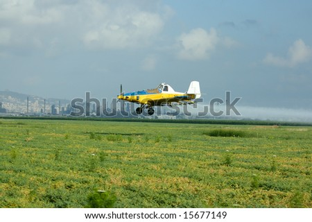 flight of the yellow agricultural airplane