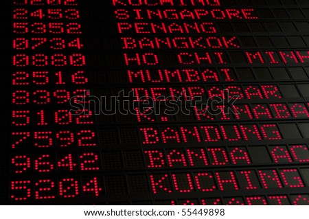 flight schedule in airport, air destination such as Singapore, Bangkok, Ho Chi Minh city, Mumbai and others can be seen. - stock photo