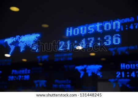 flight time on led board of city - stock photo