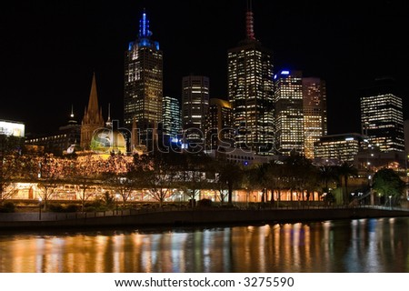 Flinders Street Station and Melbourne Business skyline at night.