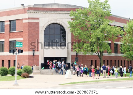 FLINT, MICHIGAN-JUNE, 2012:  Students standing in front of Kettering University, one of the best engineering schools in the mid-west United States.  - stock photo