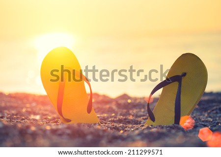 flip-flop on the beach  - stock photo