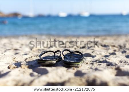 flip flop on the beach - stock photo