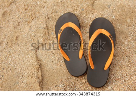Flip flop shoes on the tropical beach - stock photo