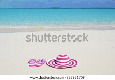 Flip-flops and hat on the beach of Exuma, Bahamas - stock photo