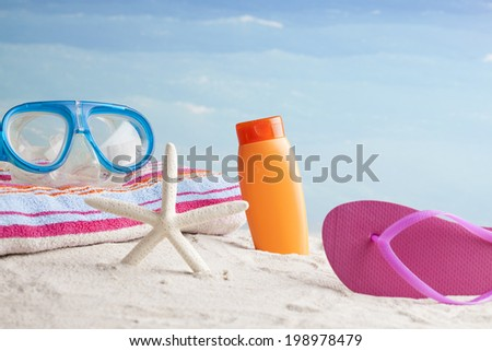 flip-flops and starfish with beach accessories  - stock photo