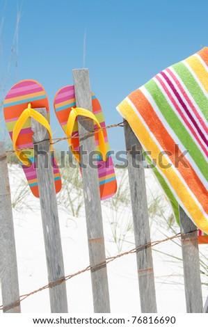 flip flops hanging on fence - stock photo