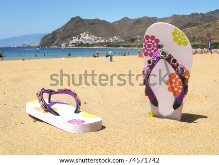 Flip-flops in the sand of Teresitas beach. Tenerife island, Canaries - stock photo