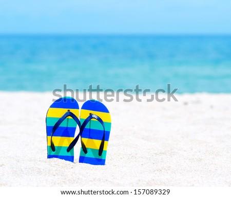 Flip flops on a tropical beach. - stock photo
