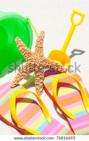 flip flops on beach sand - stock photo