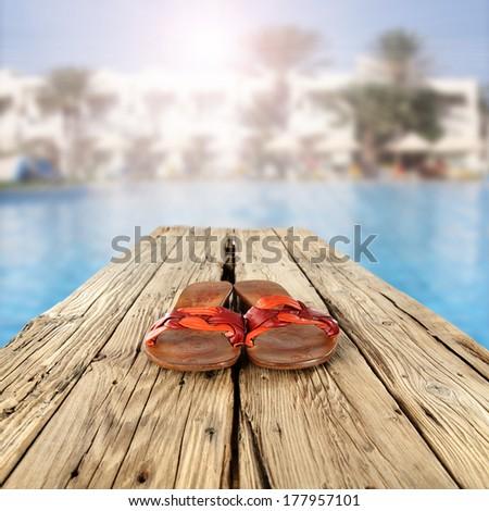 flip flops on desl  - stock photo