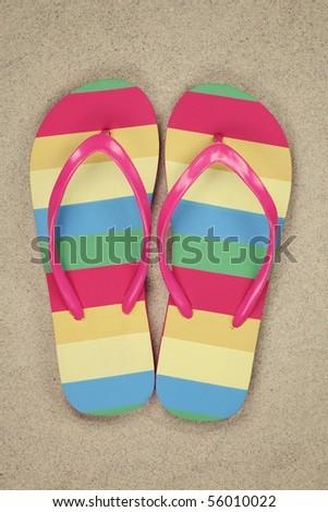 flip flops on sand beach - stock photo