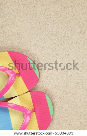 flip flops on sand beach with copy space - stock photo