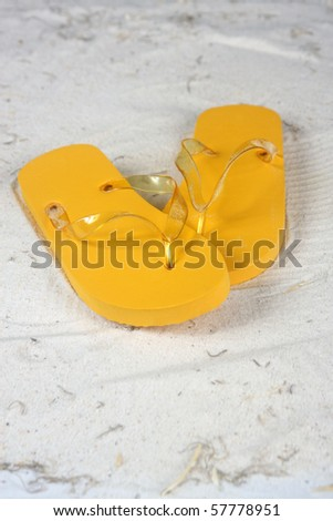 Flip flops on the beach  with copy space - stock photo