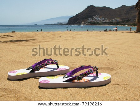 Flip-flops on the sand of Teresitas beach. Tenerife island, Canaries