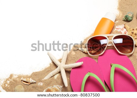 Flip flops,sunglasses,sunblock,seashells with sands,Copy space for your text. - stock photo