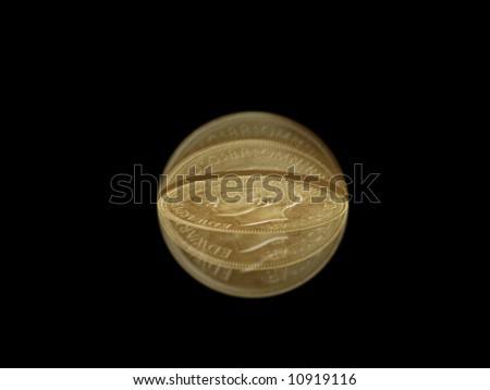 Flipped coin isolated in motion against a black background - stock photo