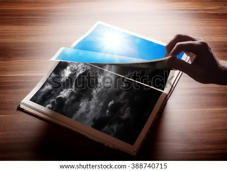 Flipping pages of a book. Concept for result of reading, or a new good day after a bad day, or involvement in switching from darkness to light... - stock photo