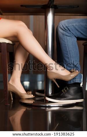 Flirt. Man and woman flirting while a dinner - stock photo