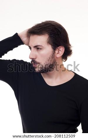 Flirtatious glance, male touching to his hair.  - stock photo