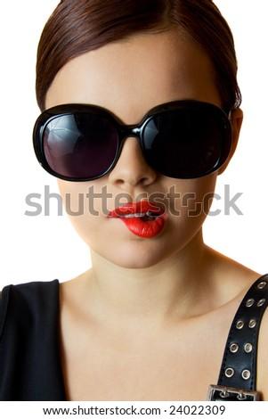 Flirting brunette wearing big eyeglasses - stock photo