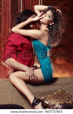 Flirting couple enjoying together in a luxury room. - stock photo