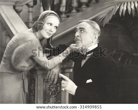 Flirting with her sugar daddy - stock photo