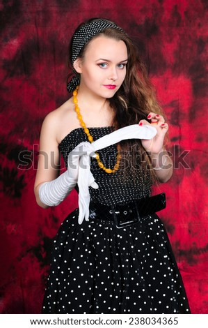 Flirty girl in vintage dress with glove - stock photo