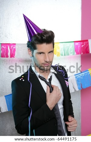 Flirty young party man seductive gesture view facing camera - stock photo
