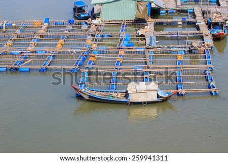 Float fishing village, Long Son, Long Hai, Ba Ria- Vung Tau Vietnam. People living and doing feed fish industry at floating village.